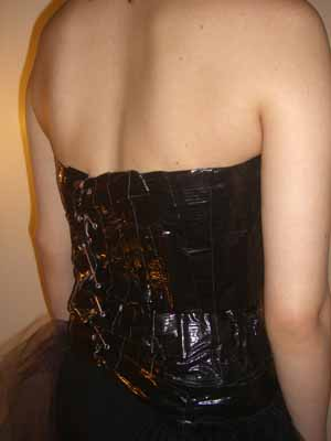 After cutting the back open and binding the cut with more duck tape grommets were used to lace the bodice closed.