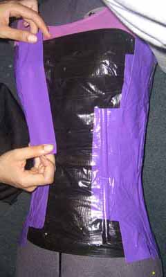 Layer two is shown in purple. This layer is vertical and goes over the drinking straws on layer one.